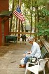 Susan husking corn on the deck in Michigan.jpg